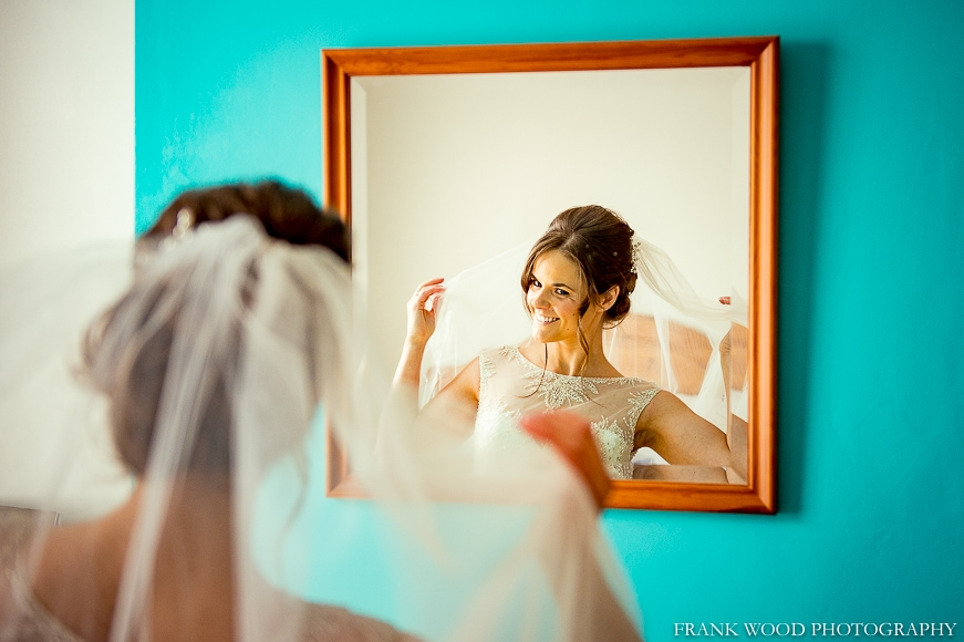 Bride in the mirror getting ready